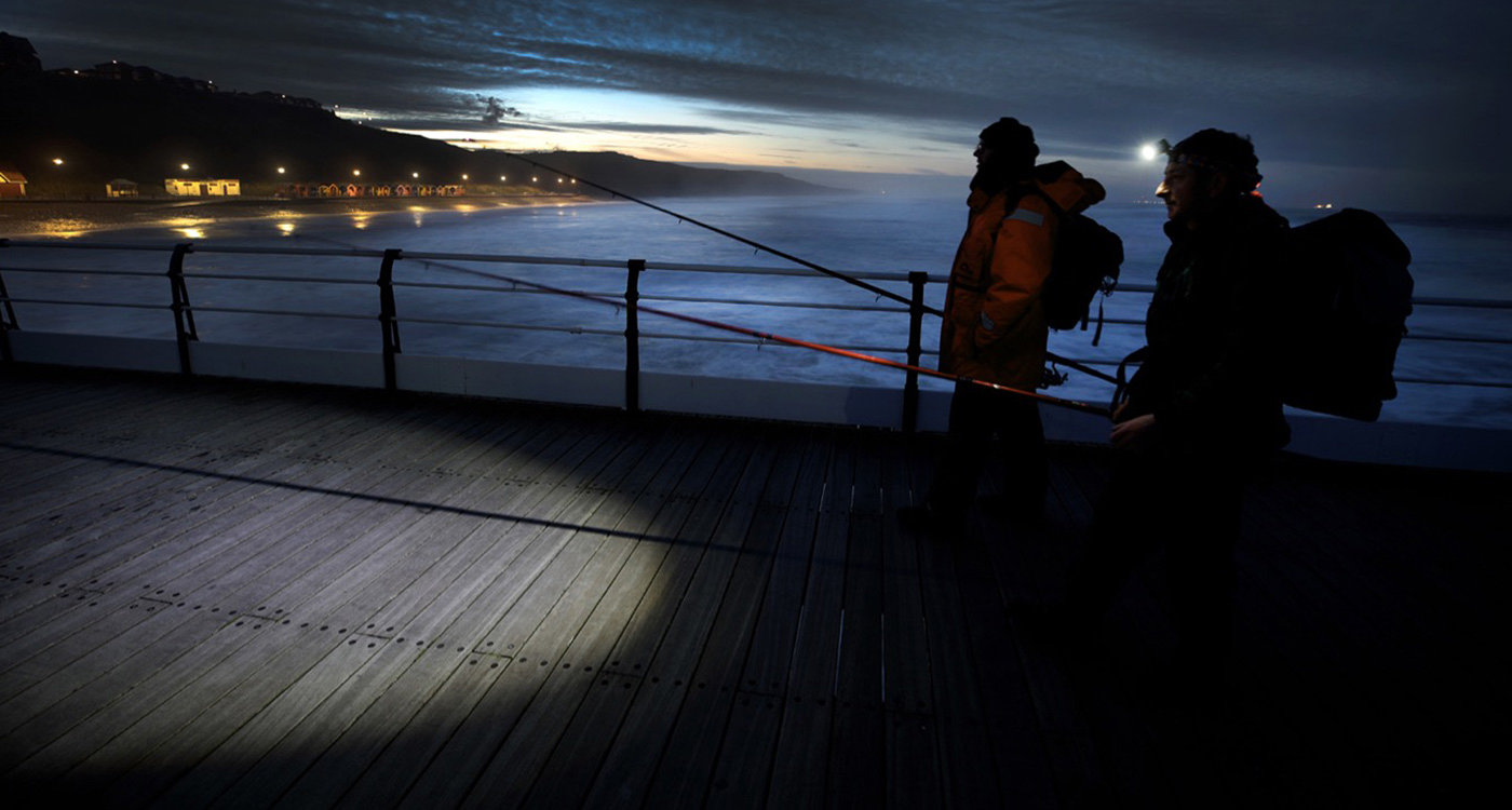 Commercial Photography in Saltburn of fishermen on the pier